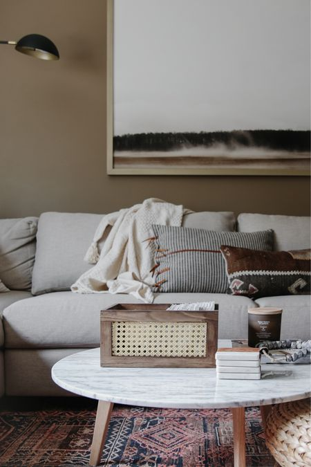 Cozy fall living room, throw blankets, throw pillows, leather throw pillows, rattan   #LTKSeasonal #LTKunder50 #LTKhome