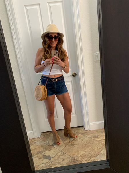 Now that concerts are back up and running, I've got the perfect outfit for ya! Simple cutoff denim Levi's, white tank crop, some booties, a hat and a cute straw crossbody. Can't forget the shades. It helps Levi's is having a major sale with 40% off!  Happy early Labor Day! 😎 #ltksale   #LTKstyletip #LTKunder100 #LTKSeasonal