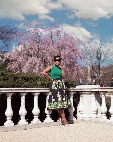 Green sleeveless top black printed circle skirt white strappy sandals #travelstyle #vintagestyle #vintage #retro #competition  #LTKstyletip #LTKSeasonal
