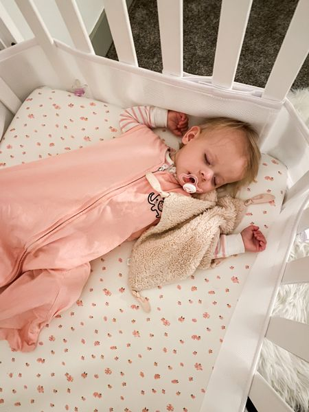 Linked this sleeping champion's crib sheet, lovey, jammies, and sleep sacks!