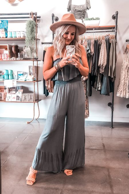 Blue gray jjmpsuit Original: apricot lane vb Casual jumpsuit Strapless jumpsuit Ruffle leg jumpsuit Wide leg jumpsuit Fedora hat tan braided heels  #LTKunder50 #LTKunder100 #LTKsalealert