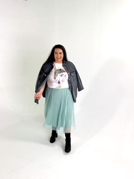 Obsessed with mixing my skirt with casual graphic tees + combat boots and denim   #LTKcurves #LTKunder50