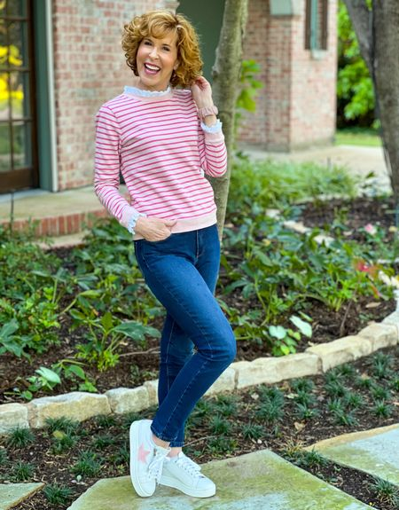 Ruffle neck sweatshirt, Fall outfit, breast cancer awareness, Pink sweatshirt, eyelet trim, Dark wash jeans, Mott & Bow jeans, Pink earrings, Kendra Scott earrings  This pink striped sweatshirt (15% off right now) has the sweetest eyelet ruffles at the neck and wrists! I paired it with indigo wash jeans (forever THE most flattering wash), and pink sparkly earrings, of course! Pink star shoes can be found at Sole Bliss - use code ENB15 for 15% off!  #LTKunder100 #LTKstyletip #LTKSeasonal