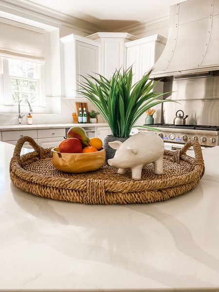 Love this kitchen vignette with the woven tray, faux fruit and ceramic pig.  Kitchen decor, tray ideas, faux fruit, tray  #LTKhome