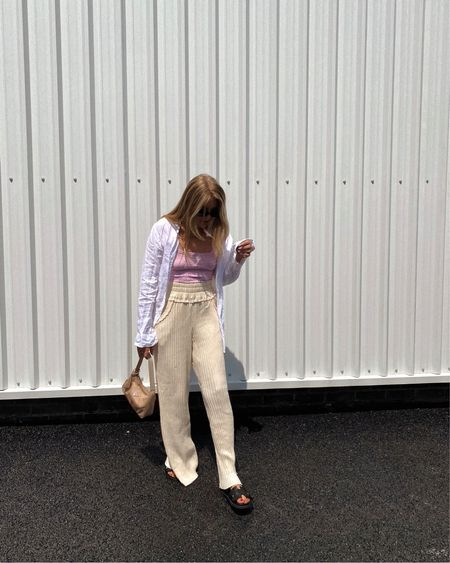 Free people summer outfit, white oversized shirt, cream trousers, knitted trousers, black sandals, pink top . Pink cami @liketoknow.it #liketkit http://liketk.it/3gTF4 #LTKeurope #LTKstyletip #LTKunder100