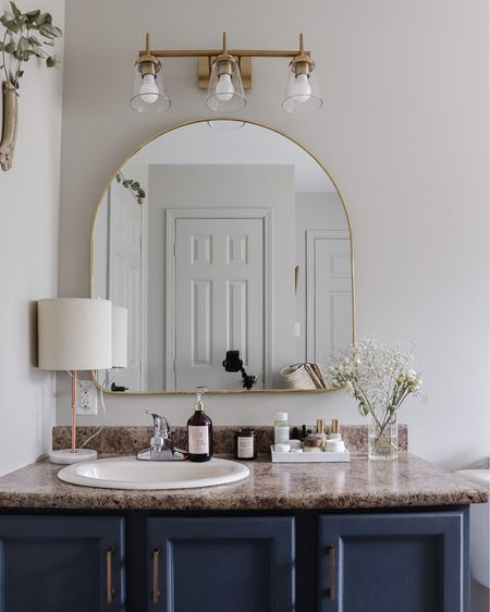 Phase 1 of our $300 Bathroom Renovation is done! But the statement piece is the beautiful affordable arched mirror! Here are 15 arched mirrors that are perfect for any space. http://liketk.it/3daJx #liketkit @liketoknow.it #LTKhome #LTKsalealert #LTKunder100 @liketoknow.it.home Shop your screenshot of this pic with the LIKEtoKNOW.it shopping app