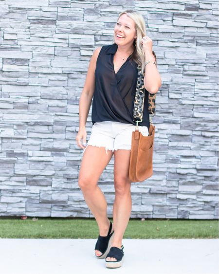 Love this black pho wrap top blouse with these white three people McKay shorts and black platform wedges. Take 10% off of the shorts and the top with code VIP 10. Also loves this vegan leather Crossbody bag and bag strap. Summer outfit ideas black and white summer shirts tops Jean shorts  #LTKsalealert #LTKstyletip #LTKSeasonal