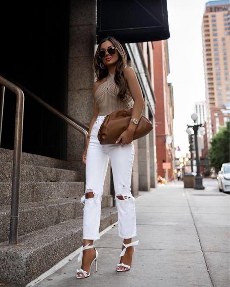 Summer outfit Beige halter top Abercrombie white jeans Bottega Veneta The Pouch Bag  Bottega Veneta sunglasses   http://liketk.it/3if79 #liketkit @liketoknow.it #LTKunder100 #LTKstyletip #LTKitbag