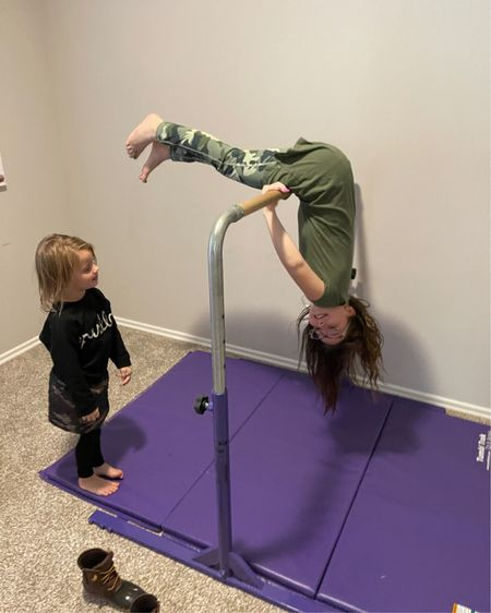 """The best """"toy' investment we've made. This gymnastics bar and purple mat has provided the girls endless hours of entertainment for the past 4 years. Kid approved @liketoknow.it #liketkit http://liketk.it/36iKD #LTKhome #LTKkids"""