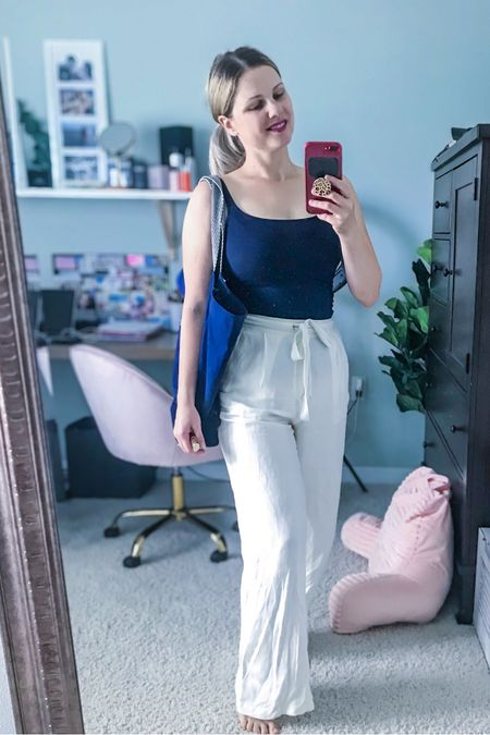 Wearing a navy sleeveless tank/bodysuit with white linen pants. Perfect athleisure outfit for end of summer 😎  http://liketk.it/2WqX9 #liketkit @liketoknow.it #LTKstyletip #LTKunder100 #LTKcurves