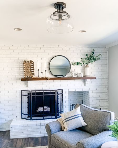 New addition to the fireplace room! Our light! I love how simple and elegant it is and how it doesn't take from our new fireplace! Link in my bio for links to everything - follow our like to know it! http://liketk.it/39WO5 #liketkit @liketoknow.it #StayHomeWithLTK @liketoknow.it.home You can instantly shop my looks by following me on the LIKEtoKNOW.it shopping app