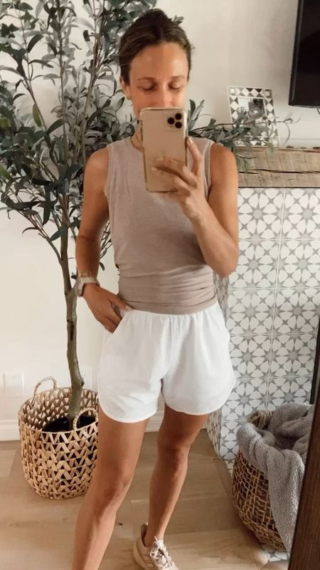 Breathable lined perforated running shorts great for warm weather workouts. Wore them for my 7 mile run this morning and they were great. I could have gone down a size but didn't want them too tight so if you're between sizes I recommend sizing down//   #LTKfit #LTKunder100 #LTKunder50