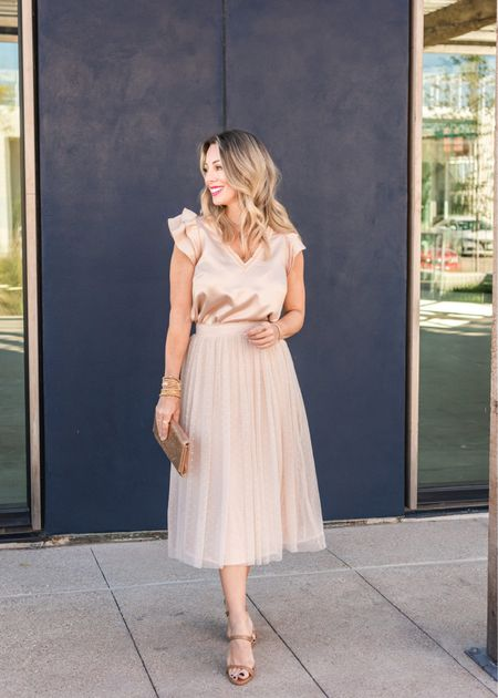 You'll always feel like a princess in a tulle skirt!  This one is cut like the lace midi skirt above with a side zip, but instead of lace, it has three layers of tulle and organza with a fun, dotted top layer.  Top Fit: I'm wearing an XXS  Skirt Fit: I'm wearing an XXS  #LTKSeasonal #LTKstyletip #LTKHoliday