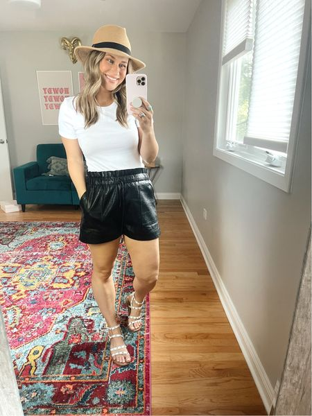 The perfect casual outfit. Paired these faux leather shorts with the perfect whit T-shirt, sandals and a cute little bath  #LTKshoecrush #LTKstyletip #LTKunder50