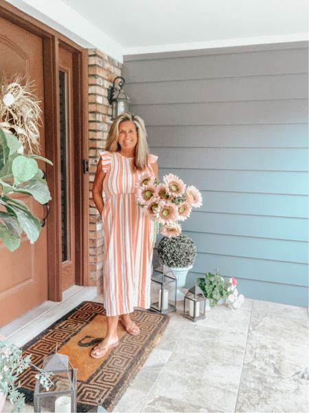 August is here and it brings intense heat.  It's so hard to think that Fall is around the corner. While everything from summer seems to crisp up no matter how many times you water,  fall colors seem to creep in and change the scenery. It also changes our wardrobe and even colors.  I picked up this  #targetstyle orange stripe midi and love how it will transition into fall with a simple jacket or sweater.   I'm trying to hang on to what's left but I'm also preparing for the crisp cool fall mornings.    #target #sharemytargetstyle #style #mystyle #fashionista #shopltkit  #LTKunder50 #LTKstyletip