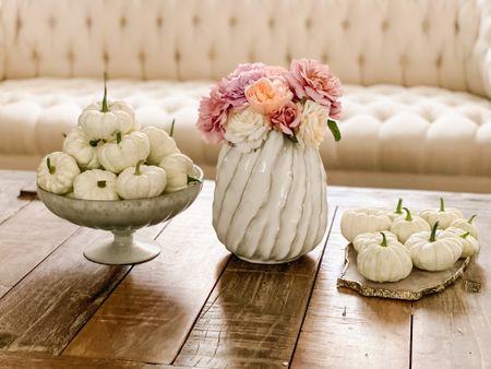 Gorgeous white ceramic vase under $40, fresh white mini pumpkins from my garden, agate cheeseboard, white upholstered chesterfield sofa, rustic coffee table! Living room inspiration. Home decor. Living room decor. Living room furniture. ❤️   #LTKSeasonal #LTKunder100 #LTKhome