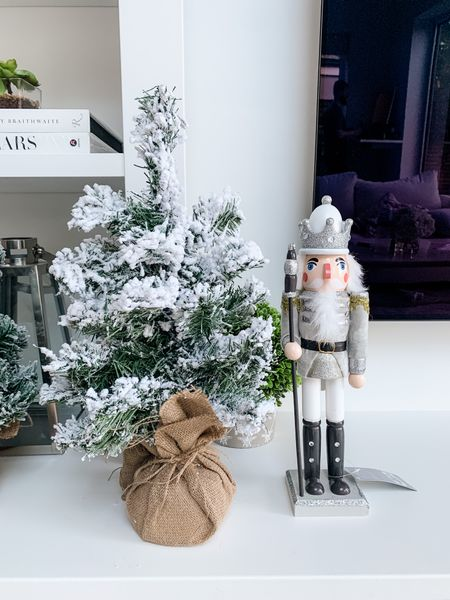The most adorable Christmas decor that's super affordable too 😍   Flocked mini desk Christmas tree and nutcracker decoration 🥰✨