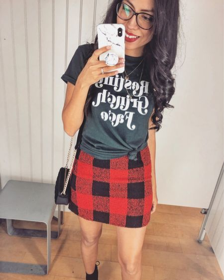 I am definitely not the most festive person so you can see how this graphic tee is so fitting 😆 #RGF && the plaid mini skirt was just so cute so I had to get it. Hope all you babes are having a great Monday and stay tuned for a little surprise I have for you this evening.  Shop my look on the @liketoknow.it app or through the link in my bio http://liketk.it/2ySpW   #liketkit #LTKunder50 #LTKholidaystyle #LTKholidaywishlist #casuallooks #stylereport  #fashiontips #outfitshare #instafashionist #instalookbook #styleshare #whowhatwearing #affordablestyle #realoutfit #miamiblogger #miamistyle #miamilife #effortlessstyle #wearitloveit #everydaystyle #momstyle #modalatina #modafemenina #modamujer #rewardstyle #americanstyle #everydaystyle #dressmeforless