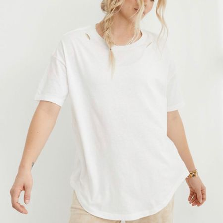 """My favorite distressed shirts are on sale for only $15!!! These are ALWAYS sold out! I love these because they have a loose fit, and they are soooo comfortable! I linked some that are distressed and have holes in them, and some that aren't distressed! These are my FAVORITE! I just ordered a bunch!   www.bombshellbeads.com use code """"KIM"""" for 20% off!   #LTKsalealert #LTKunder50 #LTKSpringSale"""