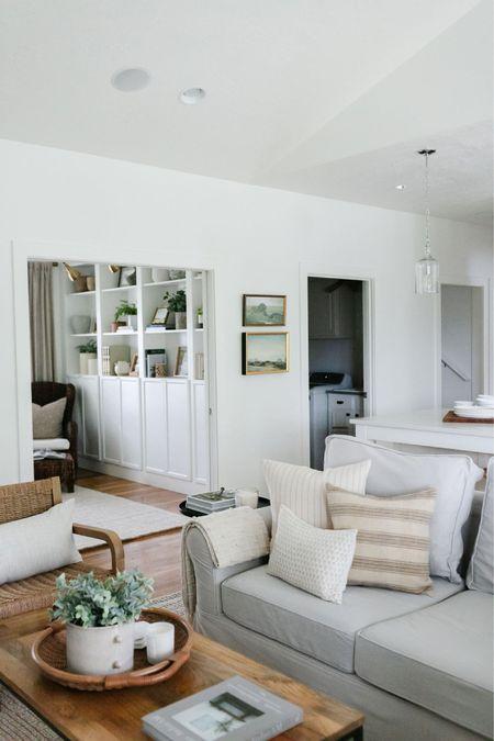 Living room decor inspiration. Pottery Barn sectional with neutral pillows, decor and artwork.   #LTKhome #LTKunder50 #LTKunder100