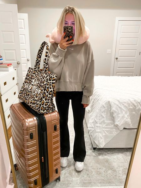 Travel outfit, airport outfit Nike pullover (XS) with black flare pants (XS short)   #LTKSeasonal #LTKtravel #LTKstyletip