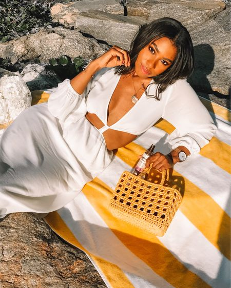 Channeling angelic vibes in the white deep-v cutout midi dress from WAYF Clothing. It's available on EBay! I linked my yellow summer basket tote bag and my go-to sunscreen mist from Hawaiian Tropic.   http://liketk.it/2T0VG @liketoknow.it #liketkit #LTKspring #LTKswim #LTKunder100
