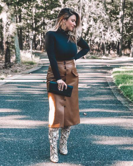 @liketoknow.it http://liketk.it/2F1lt #liketkit #LTKstyletip #LTKunder50 #LTKshoecrush  .. Cattle baron's ball, leather skirt, bodysuit, snake print boots