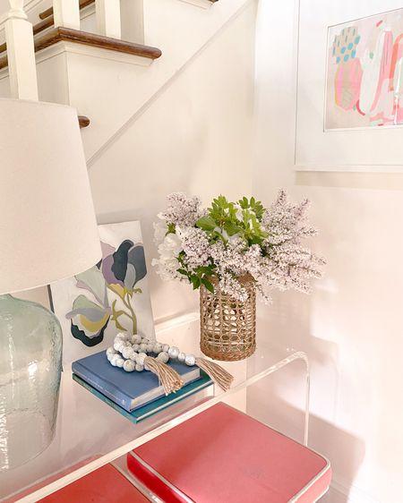 Console styling, Fresh flowers, acrylic console table, coastal living, Britt bass artwork, console, cB2 console peekaboo table, table lamp, fine artwork  http://liketk.it/3g721 #liketkit @liketoknow.it @liketoknow.it.home #LTKhome