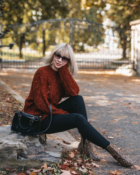 Snake print boots and sweater street style  http://liketk.it/2GJiS #liketkit @liketoknow.it #LTKholidaystyle #LTKeurope #LTKshoecrush