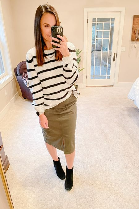 Midi skirt, black and white striped sweater with black booties.   http://liketk.it/3d3Ar #liketkit @liketoknow.it   You can instantly shop all of my looks by following me on the LIKEtoKNOW.it shopping app