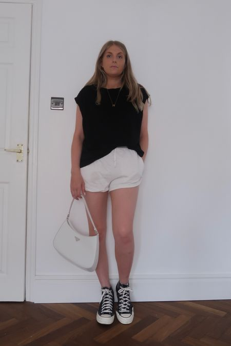 Causal outfit, summer outfit, Prada bag, white bag, converse outfit, black converse , H&M top, oversized tee, racer shorts, arket shorts @liketoknow.it #liketkit http://liketk.it/3kaxm #LTKeurope #LTKstyletip #LTKunder100