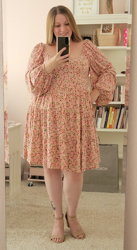 This dress from Eloquii is so pretty. Check out this floral puffed sleeve dress for plus size ladies. For reference I am wearing a size 16.  #LTKfit #LTKcurves #LTKstyletip