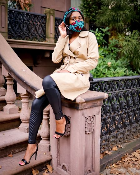 Fall fashion. Amazon fashion finds wearing a tan trench coat, stunning printed mask with matching headband, open-toe sandals, and faux leather Moto leggings. Use code LOUISA10 to save on your Spanx order. Shop exact items below (all run TTS) and follow me fore more affordable fashion finds.   #LTKshoecrush #LTKFall #LTKstyletip