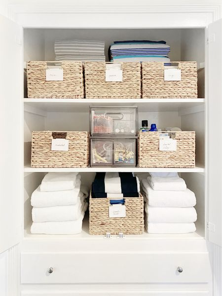 Organize your linen closet by containing sheets in baskets and all your medicine cabinet supplies in clear stacking bins #organized #homeorganization  #LTKhome  #LTKfamily