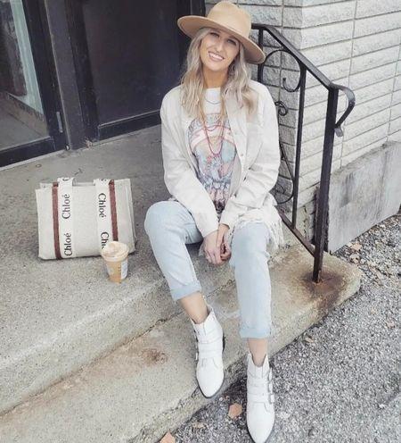 Boho western outfit inspo Graphic tee, oversized fringe shacket, light wash denim & white boots  http://liketk.it/3p2Rg @liketoknow.it #liketkit #LTKGiftGuide #LTKHoliday #LTKSeasonal #LTKbeauty #LTKitbag #LTKsalealert #LTKshoecrush #LTKstyletip #LTKtravel #LTKunder50 #LTKunder100