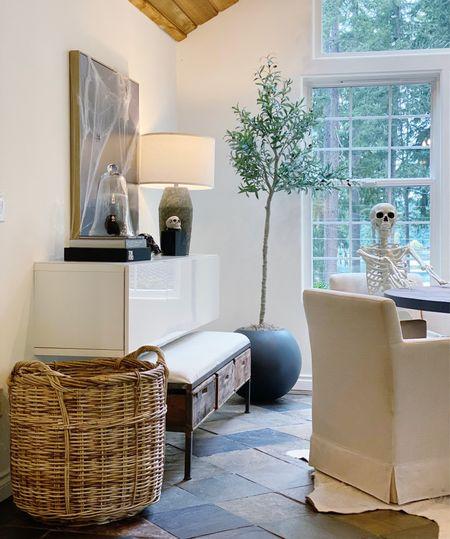 Dining room with large basket, extra storage, Halloween decor, studio mcgee for target art, crate and barrel planter and great olive tree!   #LTKsalealert #LTKhome #LTKstyletip