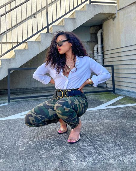 Linked white button down, gold chain necklace, camo pants, black cat eye sunglasses, and clear heels.   #LTKstyletip #LTKunder50 #LTKunder100