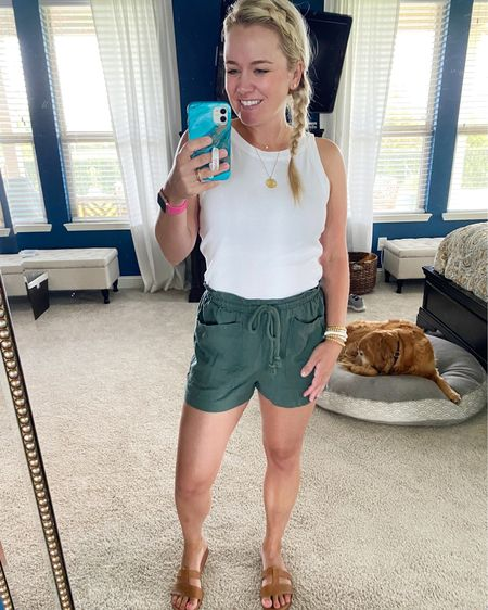 Hello sweet summer!! These comfy shorts are giving me all the hot weather vibes (while still feel cool and cute). I love these halters from Loft, too! They go so well tucked into shorts and pants. The slides are a great neutral pair of shoes, too.    http://liketk.it/3ij3C #liketkit @liketoknow.it #LTKunder50 #LTKunder100 #LTKshoecrush