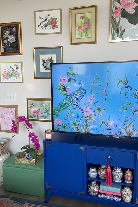 This little corner is making my grandmillennial decor loving heart smile🥰 Loving my new chinoiserie art prints and blue entertainment center shelves! The tassel and green storage ottoman are new and adding the perfect pop of color. Linking exact and similar items here!  #LTKhome #LTKstyletip #LTKunder100