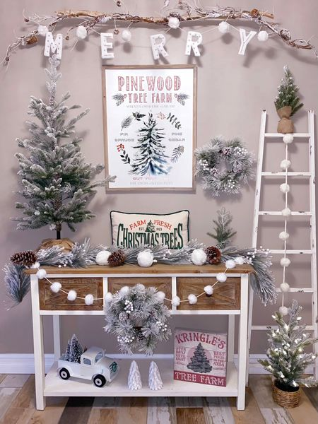 a hallmark movie worthy Christmas tree farm entryway 🌲 created by Twinkle Lights and Cornbread ❤️  Hallmark channel, tree farm, tree farm entryway, farmhouse entryway, entrance table, barn drawers, white entrance table, wood entrance table, white ladder, white pick-up truck, snowball garland, white console table, farmhouse console table, wood console table   http://liketk.it/32sja #liketkit  @liketoknow.it @liketoknow.it.home  #LTKhome #LTKstyletip