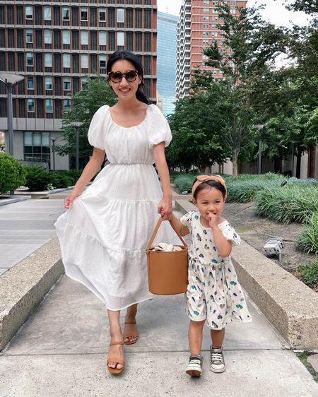 Mommy & me summer style Astr dress size Xs (looser fit in the chest, I have the back center taken in) Similar sandals linked Thierry lasry sunglasses Www bucket bag with removable crossbody strap and removable canvas liner bag Nori is in Tucker & tate dress size 3T toddler ( so comfy, cute and has pockets) See Kai run Peyton sneakers   http://liketk.it/3kT1B #liketkit @liketoknow.it @nordstrom #nordstrom  Zara kids headband  #LTKunder100 #LTKfamily #LTKkids
