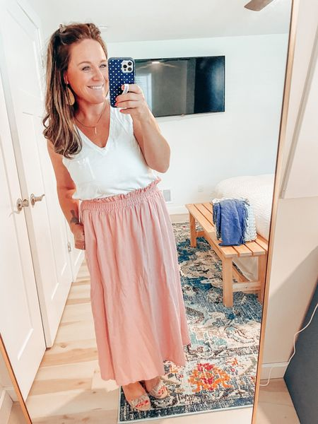 Another perfectly adorable smocked skirt that is so affordable and comfy! Pockets & plenty of length make this another cute option for teachers heading back to the classroom. Graphic tee or white tank, either works!   #LTKworkwear #LTKunder50 #LTKstyletip