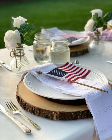 Set a festive, welcoming setting for your Independence Day Celebrations & Gatherings with inexpensive American flags and staples you'll use again and again! ❤️💙  A Wood Slice chargers and Ball Glass jars bring so much character to each placesetting!   White Plates Canning jars White Faux Florals  http://liketk.it/3gXpz #liketkit #LTKDay #LTKunder50 #LTKhome @liketoknow.it @liketoknow.it.home @liketoknow.it.family  Shop my daily finds by following me on the LIKEtoKNOW.it shopping app 🙌