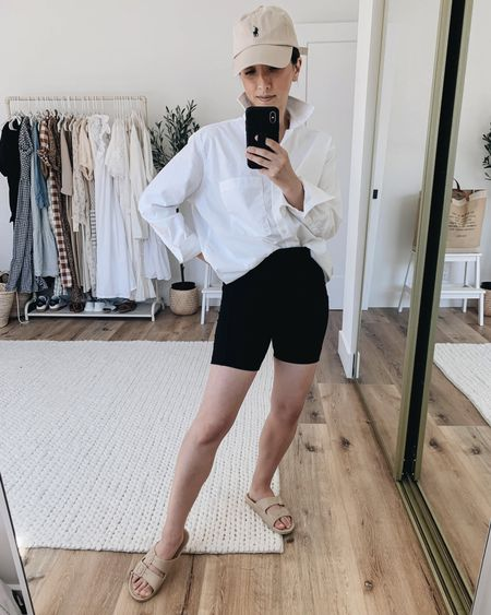 How to style a white button down. White button down with biker shorts.  Shirt- AYR xs Shorts- Amazon small  Slides- Freedom Moses 4/5 Hat- Polo Ralph Lauren   http://liketk.it/3ioaK @liketoknow.it #liketkit #LTKstyletip #LTKunder100