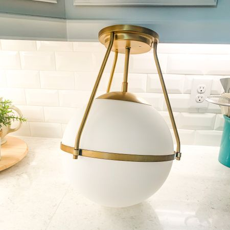 Semi-flush globe pendant, brass pendant, coastal lighting http://liketk.it/3eOhc #liketkit @liketoknow.it