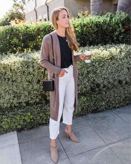 My exact long cardigan is sold out, but I linked similar with pockets in tan. Tee and jeans run TTS. Western mule heels are sold out in tan but available in brown and black. Run TTS.  #muleheels #heeledmules #blockheelmule  #CardiganOutfit #TanCardigan #LongCardigan #DusterCardiganSweater