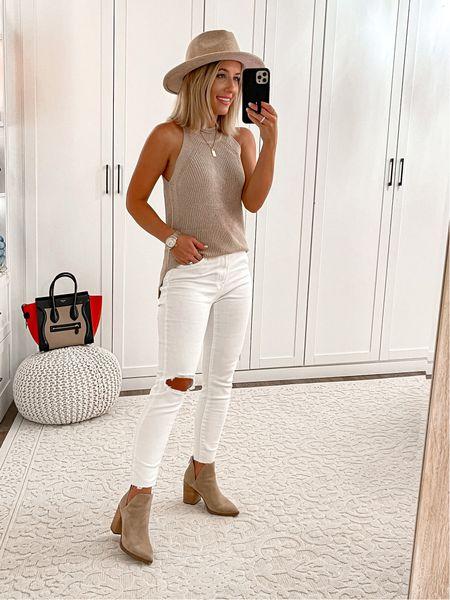 Tap Amazon outfit Sweater tanks size small White Levi's jeans size 25 Amazon fedora hat Tan booties size 7 Celine micro bag  #amazon #fall #laurabeverlin  #LTKsalealert #LTKunder100 #LTKunder50