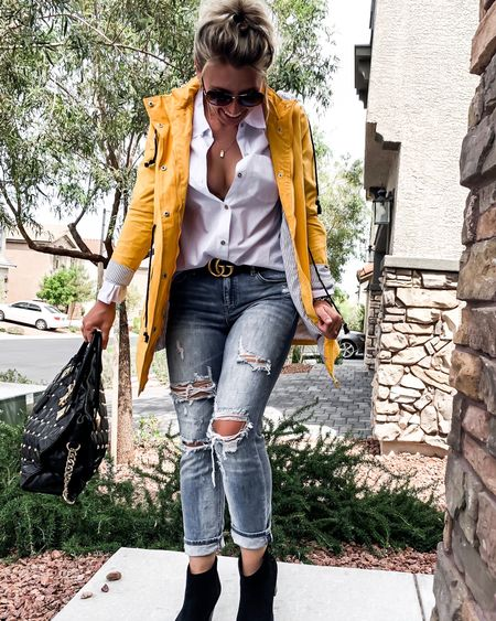 Rainy day outfit. Business causal or just running errands. Nice pair of denim jeans and button up shirt paired with a rain coat and designer belt and bag   #LTKstyletip #LTKshoecrush #LTKSeasonal