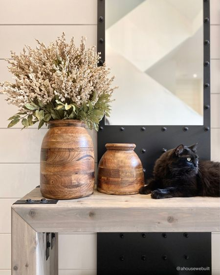 """Details from our entryway console area with my favorite wood vases and little Nyx being the cutest accent kitty! I love incorporating warm cream florals and wood tones in fall - both of them just feel so simple and cozy to me. We built the console table to tie in with our dining table and my dad made the mirror to accentuate the height of this room - plus it gives a cool reflection of our staircase. We have tutorials for the console table and shiplap, as well as sources on our website's Entryway"""" page. — Shop your screenshot of this pic with theShop.LTK app"""