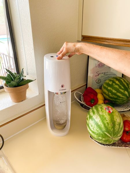 My soda stream is essential in the summer because after a few hours of gardening, a glass of cool fizzy water tastes so good. Soda stream, sparkling water, soda stream machine   #LTKfit #LTKSeasonal #LTKhome